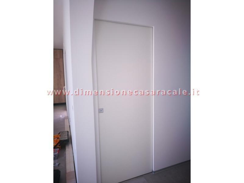 Porte interne tamburate con apertura scorrevole interno muro a scomparsa 6