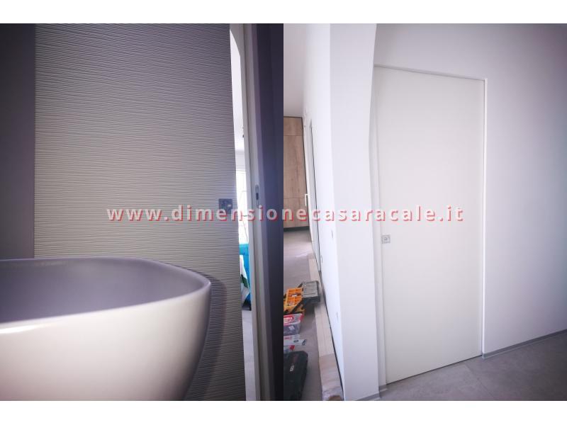 Porte interne tamburate con apertura scorrevole interno muro a scomparsa 9