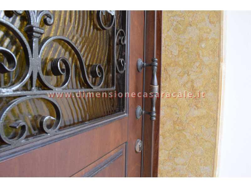 portoni in legno da ingresso Fiore Ebanisteria 5