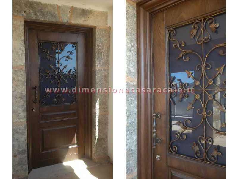 portoni in legno da ingresso Fiore Ebanisteria 8