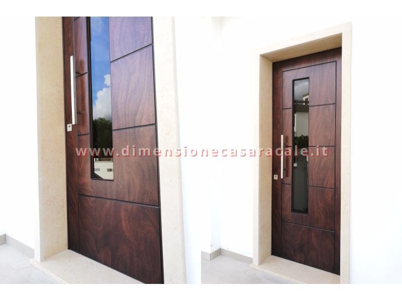 Installazione presso nuova abitazione di portoni in legno Fiore Ebanisteria certificati CE 10