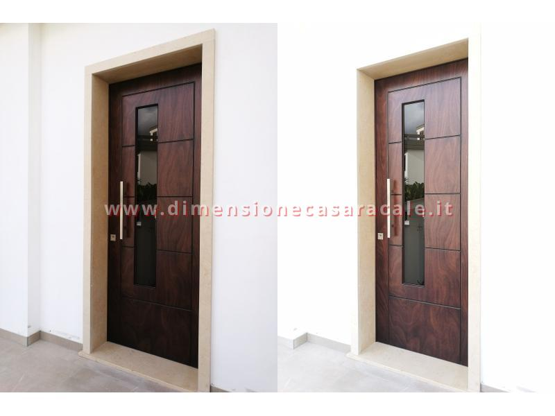 Installazione presso nuova abitazione di portoni in legno Fiore Ebanisteria certificati CE 11