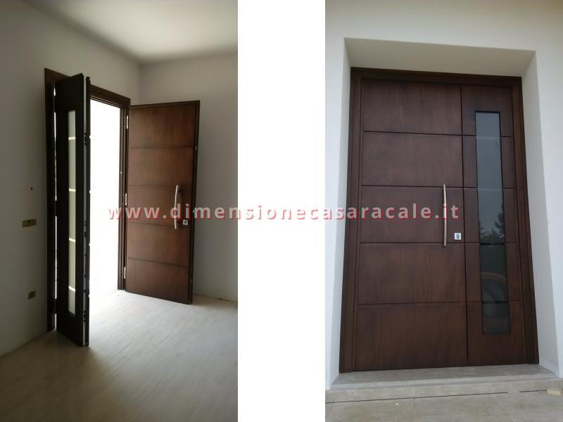 Installazione presso nuova abitazione di portoni in legno Fiore Ebanisteria certificati CE 2