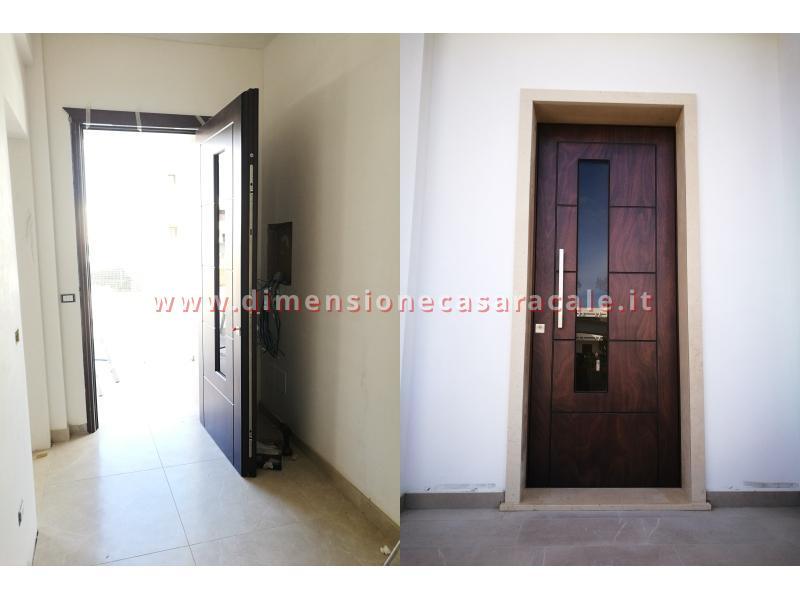 Installazione presso nuova abitazione di portoni in legno Fiore Ebanisteria certificati CE 4