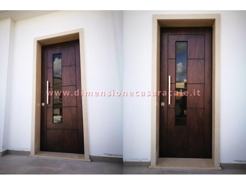 Installazione presso nuova abitazione di portoni in legno Fiore Ebanisteria certificati CE 5