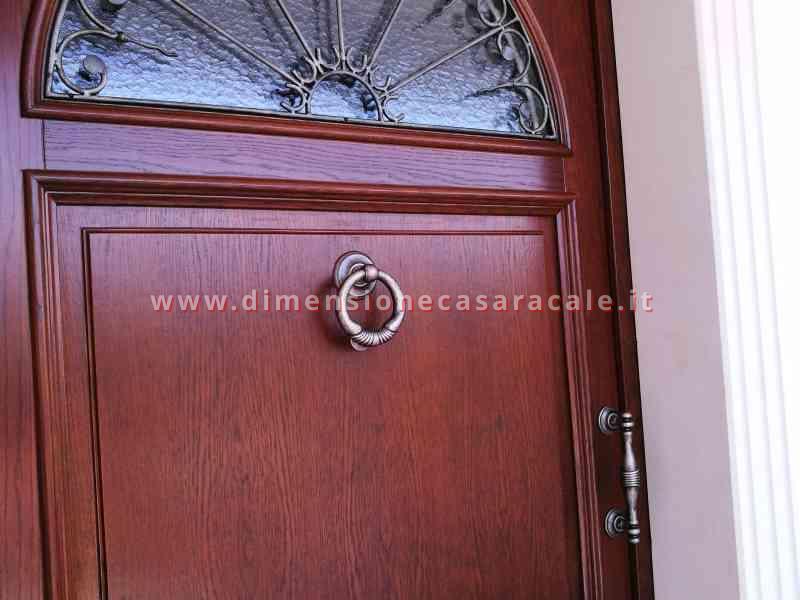 Portone d'ingresso in legno massello di Rovere tinto noce