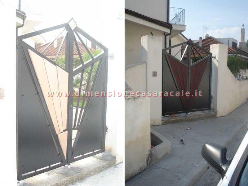 Realizzazione e installazione di cancelli sia in legno che in ferro battuto 5