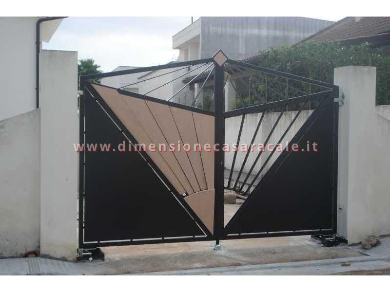 Realizzazione e installazione di cancelli sia in legno che in ferro battuto 6