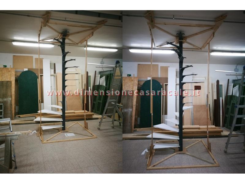 Realizzazione su misura di scala a chiocciola da interno con struttura metallica e gradini in legno 4